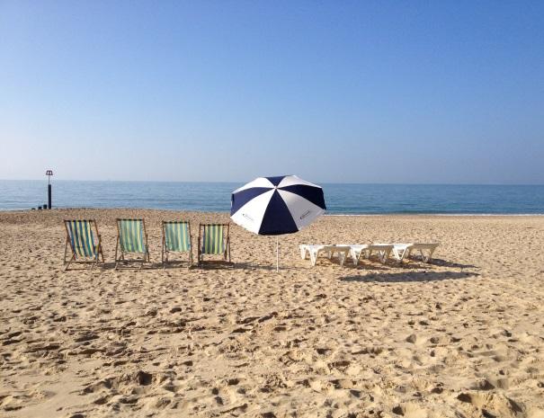 Deckchairs, sun loungers and beach umbrella