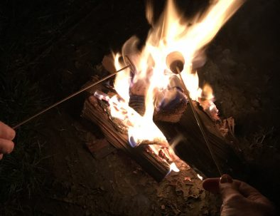 Toasting marshmallows by the campfire