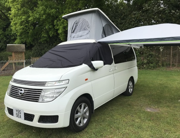 sleeping white campervan and canopy