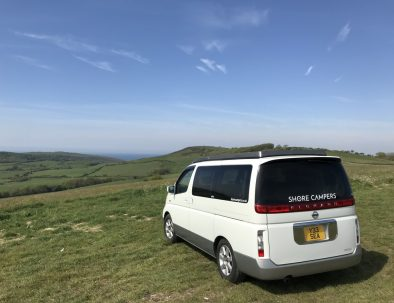 Toto the campervan surrounded by fields