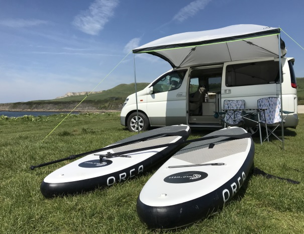 paddleboards and camper at Kimmeridge