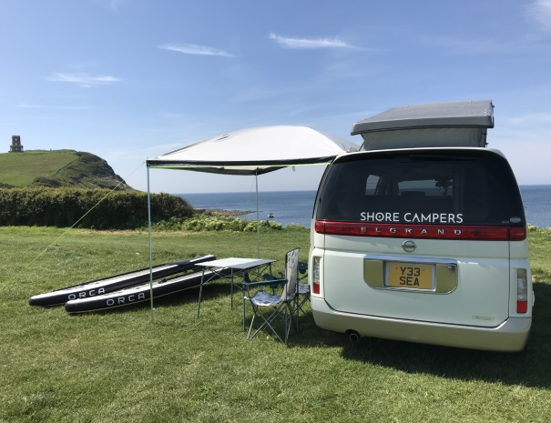 Paddleboards and campervan at Clavell Tower