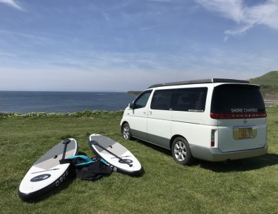 Paddleboards and Toto the campervan at Kimmeridge