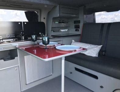 inside a campervan for dinner