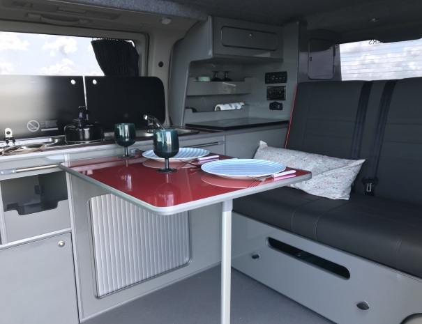 inside a campervan for dinner