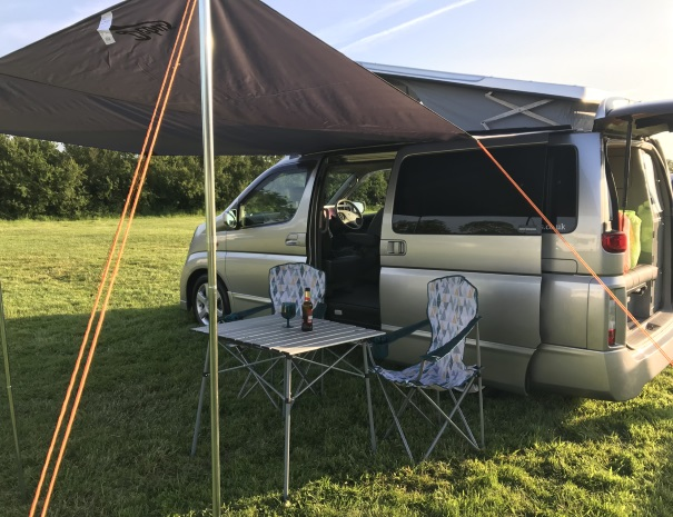 beer outside a campervan