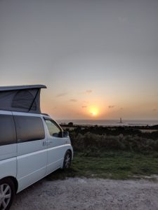campervan, pop top roof and beach sunset