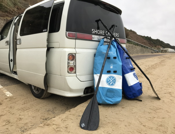 campervan and paddleboards