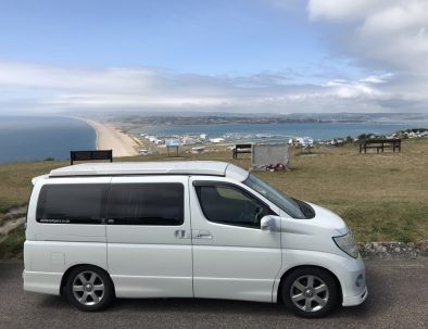 Dale the campervan overlooking Chesil
